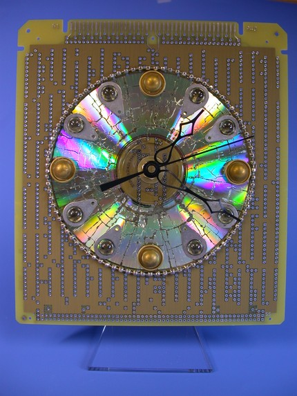 Funky Cabochoned Recycled Circuit Board and CD Desk Clock (I didn't know what a cabochon was either!)