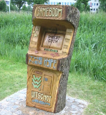 Video Game Cabinet Carved out of Tree Trunk