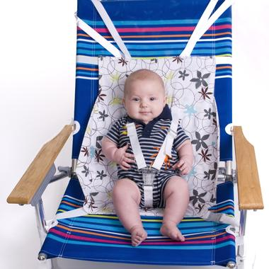 Flyebaby hammock sling attaches to your airplane seatback tray table