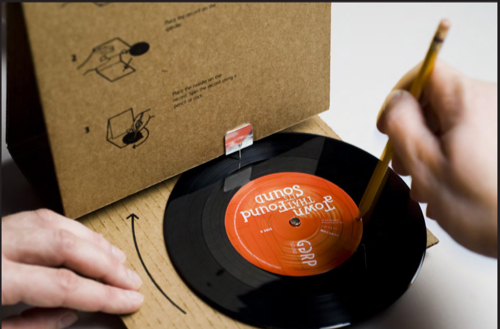 cardboard record player in use Cardboard Record Sleeve that Actually Plays the Record