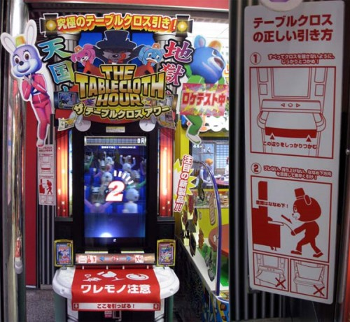 the tablecloth hour 1 500x461 Weird Japanese Tablecloth Pulling Arcade Game