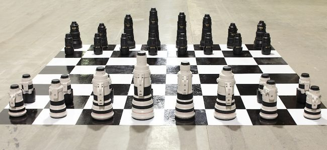 canon lens chess 650x298 Canon vs. Nikon Camera Lenses Chess Set