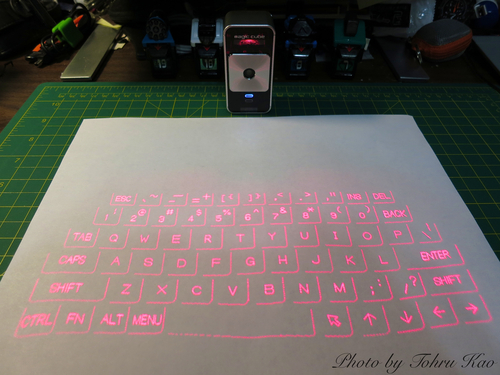celluon magic cube laser projection keyboard A laser projection keyboard used with a tablet a laser or beamer projects visible virtual keyboard onto level surface a sensor or camera in the projector picks up finger movements software.
