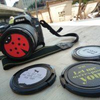 designer lens caps