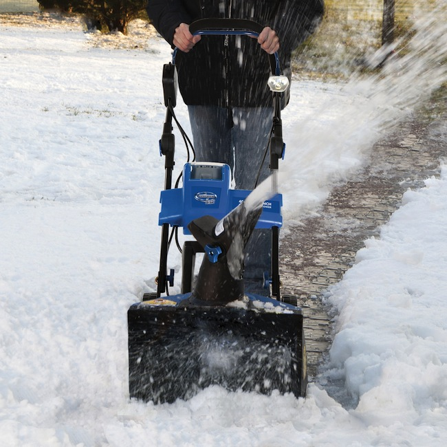 battery powered snowblower in action